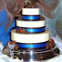 Julee's Wedding Cake  My wedding gift to my good friend! White cake filled with buttercream and sliced strawberries. Vanilla/almond buttercream frosting and...