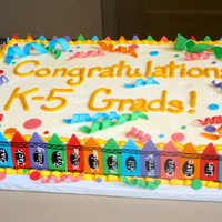 Crayon Cake Made for a kindergarten graduation. White buttermilk cake with vanilla/almond buttercream. Decorations made with 50/50 fondant/gum paste...