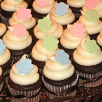 Baby Shower Cupcakes   Triple chocolate cupcakes with cream cheese/Italian cream hybrid frosting. Fondant accents.