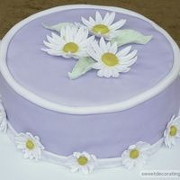 Purple Daisy Cake This was the cake I made for my final Wilton Gumpaste and Fondant class last month. The daisy's are a mixture of MMF fondant and...