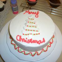 Christmas Tree I got this idea from a lady who posted a gorgeous cake on her flickr account. This is my feeble attempt, but it's not too bad....