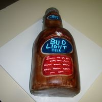 "Bud Light Beer cake made with 4 6"" cakes, torted, filled and stacked. Cupcake covered in MMF for the bottle top."