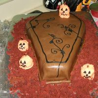 Coffin This is my copy of a cake I saw done by KoryAK. Red velvet, cream cheese filling and Rhonda's chocolate MMF. TFL!