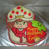 Emily's 4Th Birthday Cake! This is my first attempt at Strawberry Shortcake. Emily insisted that she have green eyes instead of blue.