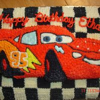 Lightning Mcqueen For Ethan This is a 11 x 15 cake decorated as a checkered flag and topped with Lightning McQueen. Ethan loved it. I had so much fun decorating it.