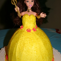 Princess Cake Vanilla cake with BC. I used a real doll and took off her legs. My daughter was so upset when she saw Bell had no legs. :) Mommy fixed them...