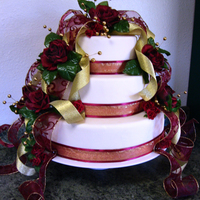 Ribbons And Roses This cake has an almost topiary feel to it. I love the rich colors. I'm afraid the photo really doesn't do it justice.