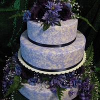 Purple Roses Cake is covered with fondant, which was textured with thinned, colored royal icing.