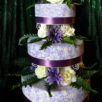 Pretty In Purple Thinned royal icing provides the texture on this cake. I like the simple elegance of the design.