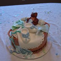 Basket Baby Shower Cake  This is 3 12in cakes (vanilla, strawberry, vanilla) with cream cheese icing and covered in MMF. The bib, onesie, bear, and tag are MMF. The...