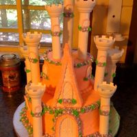 "Greta's Castle Cake  I haven't done a cake in about a year, then a year before that one so I was very rusty! I used the wilton Castle Kit and 10"" and..."