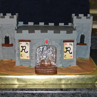 Rhodes Wedding Cake I was asked to do a castle wedding cake for a friend. She found a few pics here on CC that she liked and asked me to put a candle in the...