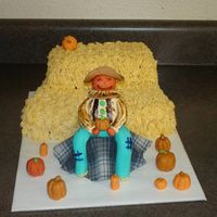Scarecrow Thanksgiving Cake  Boy did my hand hurt after doing this one. I had no strength left when it came to the last hay bail, which is why it doesnt look as good as...