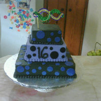 Sweet Sixteen White cake coloured purple. Black and purple with alternating polka dots.