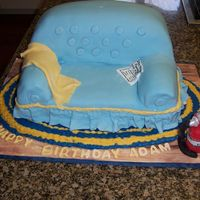 Couch Cake fondant covered cake with royal icing rug and fondant accessories