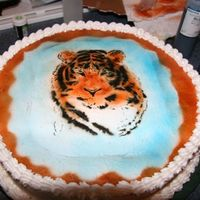 Airbrushed Tiger This is my first attempt at airbrushing a design on a cake. Airbrushing grass and sky is a piece of cake, but using templates is a bit more...