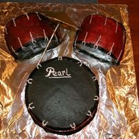Drums A coworker asked if I could make a set of drum cakes for her. I found a photo from Jenn 123 and used her idea. I used white butter cream...
