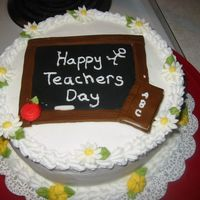 Teachers Day Cake Frosted with buttercream. Fondant chalk board, and book, royal icing flowers.