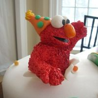 Close Up Of Elmo From Triplet Cake   gumpaste elmo with a fondant party hat!
