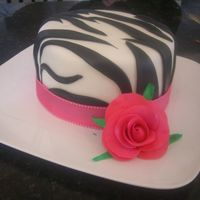 Zebra Birthday Cake Zebra birthday cake with pink ribbon and flower. The color isn't as good on the flower in the photo as it actually was but the only...