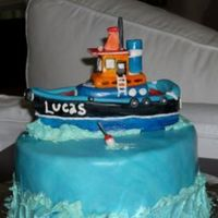 Boat Cake   A small tugboat cake for a 1 year olds party. The boat is made from fondant and gumpaste.