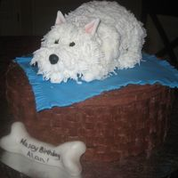 Westie chocolate buttercream basketweave base, fondant blanket and Westie made from styrofoam iced with buttercream.