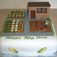 "Veg Allotment 12"" fruit cake with alloment scene, all edible except the shed which was formed with cake boards and covered with fondant for..."