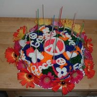 Tie Dyed Flower Power Cake This is the cake I made for my 14 year old daughter's birthday this year. She had a tie dye/flower power theme so I made her this tie...