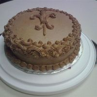 Fleur De Lis Birthday Cake  This was a lemon cake (thanks to patton78, arwa and pterrell for the recipes) with Toba Garrett's chocolate buttercream. My coworker...