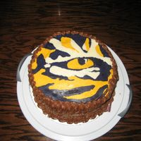 Lsu Eye Of The Tiger Cake This was my second attempt at FBCT (the first never made it off the paper!). I made this cake for an LSU fan; this is the logo that they...