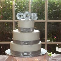 Platinum Cake   Buttercream cake with fondant ribbon and monogram in silver luster dust. TFL!