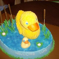 Mommy And Baby Quack Large Wilton Oval, 3-D rubber duck pan, chocolate baby duck, cattails, foilage, lilly pad and flowers are made of royal icing. All are...