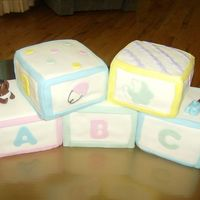 Baby Blocks  Chocolate, Carrot, and spice cakes were covered/decorated in MMF. The babies were molded by hand with MMF. These were time consumig but...