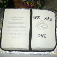 We Are One The words are on edible paper, the book mark is MMF, the rings are royal icing with silver luster dust, border is buttercream and the pages...