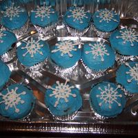 Snowflake Cupcakes I got this idea from the Wilton website, but chose to lay my snowflakes on top rather than have them stand straight up. Iced in bc;...