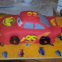 Lightning Mcqueen Just made this cake for the son of one of my husband's employees. My first fondant cake ever, as well as my first carved cake! Done in...