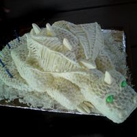 The White Dragon This is a white dragon that I made for my son's 5th birthday. It is white cake covered in MMF and painted with pearl dust. It was made...