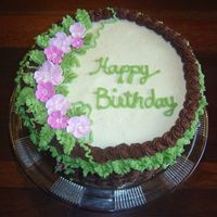 Basketweave Birthday Cake Chocolate and vanilla layer cake with fudge filling and chocolate & vanilla buttercream frosting. Royal icing flowers.
