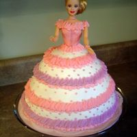 Barbie Birthday Cake Chocolate cake with buttercream frosting. I used the Wilton doll pick, but swapped her head for one off of my daughter's Barbie.