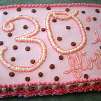Thirtieth Birthday Cake I made this fun cake for my sister-in-law's surprise party. Chocolate fudge cake with buttercream and edible glitter.