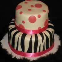 Ashley's Zebra This was made for a friend's birthday party. She requested zebra stripes and pink polka dots, so that's just what she got! I also...