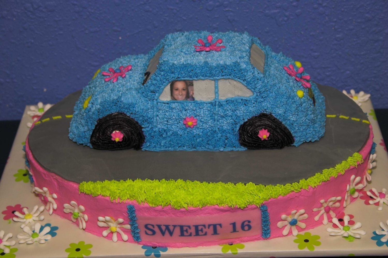 Sweet 16 Volkswagon Cake (Front View)  This is my daughter's sweet 16 cake that my mother-in-law, daughter-in-law, and even my husband helped me out on. It's a fudge...