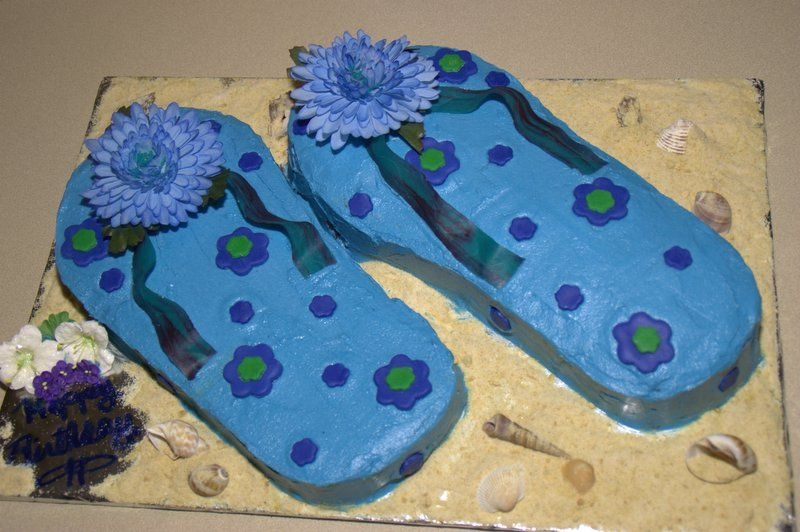 Flip Flop Ckae  This is my first attempt at the flip flop cake. I made it for my daughter's 17th birthday and she just loved it and I had fun making...
