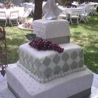 Sage/white Wedding Cake Lemon cream cake with Lemon buttercream filling covered with white and sage fondant and accents