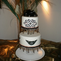 Chandelier Wedding Cake  I ordered cake dummies, and found something similar here - and just had to try it. Dont care for the stenciling on the top tier, couldnt...