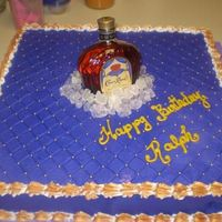 Crown Fit For A King Crown Royal on ice made with buttercream icing and rock candy for ice