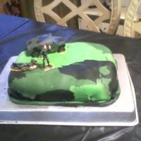 Camouflage Cake 11th Birtdhday cake with camouflage fondant and miltary men and tank on top.