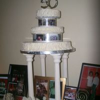 50Th Birthday Cake 3 Tier birthday cake with picture wheel as a divider. The bottom layer is vaniilathe middle layer is peach cobbler flavored and the top...
