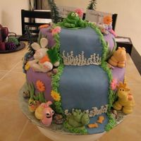 Happy Birthday Gabrielle  I did this for my boss's daughter. She told me she wanted purple icing. Two tiers, and her name on the top. And all kinds of animals....