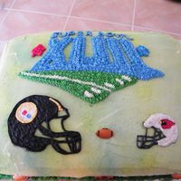 Superbowl   I did this for my boss's super bowl party. He is a steelers fan so he wanted the helmet bigger than the cardinals!!